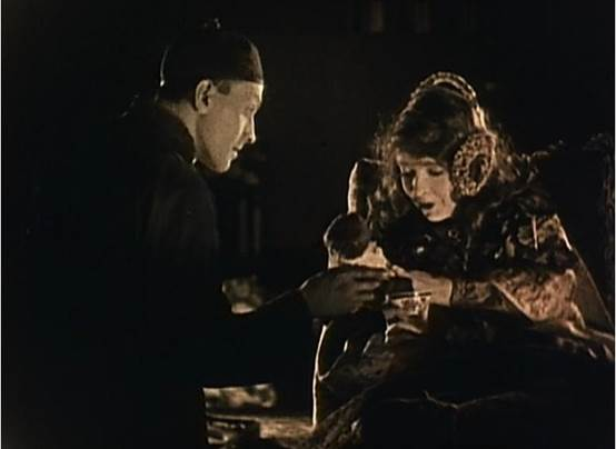 Figure 1: Cheng Huan (Richard Barthelmess) gifts Lucy (Lillian Gish) a doll in D.W. Griffith's Broken Blossoms (1919).